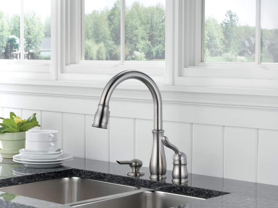 Delta 978 dst sd chrome leland pull down kitchen faucet with magnetic docking spray head and soap lotion dispenser includes lifetime warranty faucet com