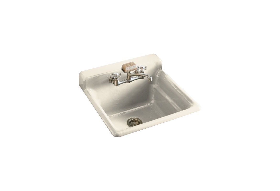 self rimming utility sink with two hole faucet drilling in backsplash