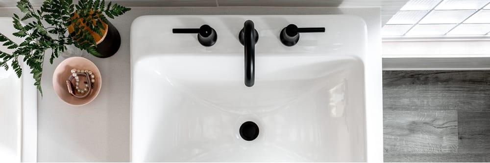 Delta trinsic widespread faucet in matte black finish.