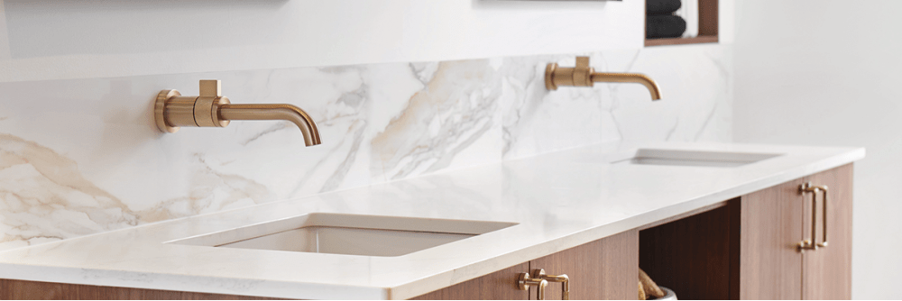 Brizo Litze single handle wall mounted faucet in luxe gold finish.
